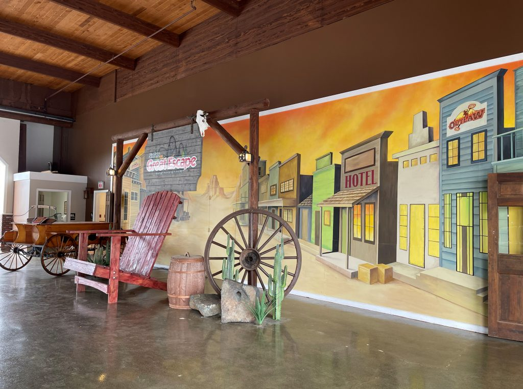 Ghost Town Mural in Red Carter Corral